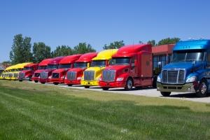 empty semi trucks in yard